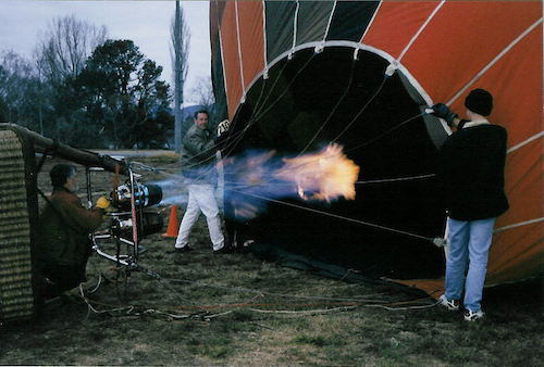 Filling the canopy with hot air